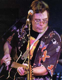 "Stephen King belongs to a an all-writer rock band called Rock Bottom Remainders with other such writers as Amy Tan, Dave Barry, Scott Turow, Roy Blount Jr. and James McBride. Their motto is, according to Barry, ""We play music as well as Metallica writes novels."""