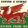 This is the Welsh flag with greetings in Welsh and English